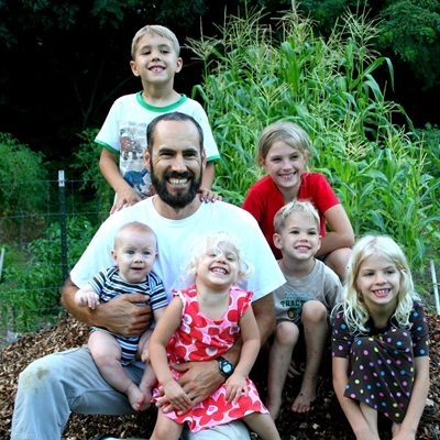 Jason with kids in garden 400x400 About Seeds for Generations