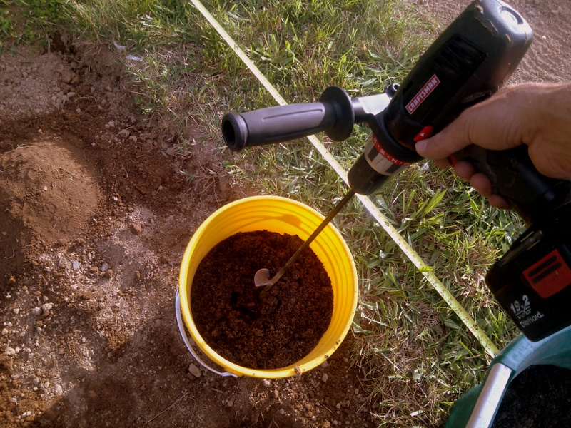 Soil amendment mixing with auger